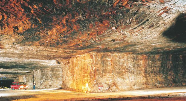 A photograph showing how some rock salt is mined, as is being done in a large underground deposit in Cheshire in England.  Much rock salt is also pumped as brine to the surface from the underground deposits.