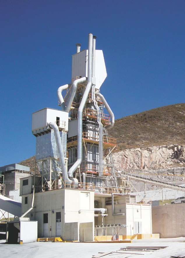 A photograph of a two shaft lime kiln for the production of lime from limestone in Mexico.