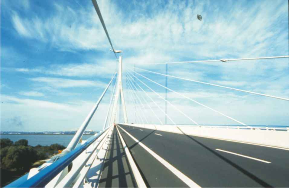 A photograph of the Pont de Normandie, in Northern France.  The road surface on the bridge has been made from co-polymers, including one using ethene and ethenyl ethanoate.  The ester is produced from ethanoic acid.