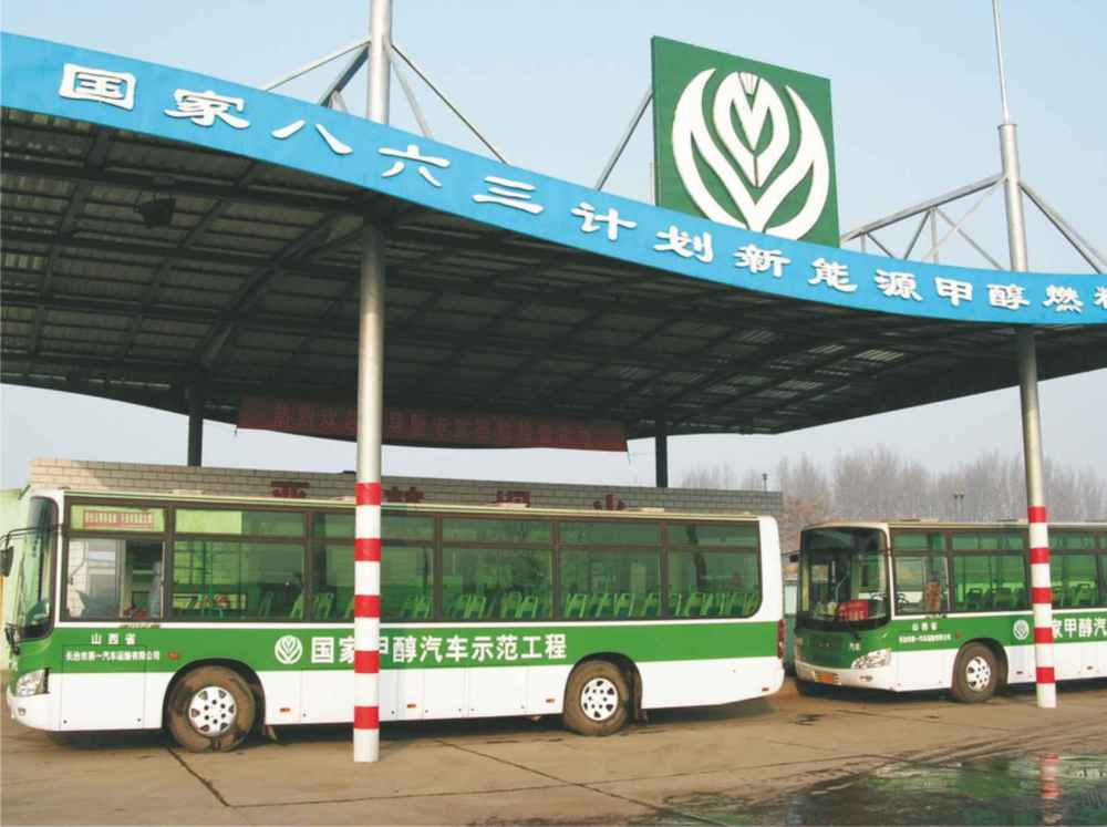A photograph of two buses in China with diesel engines, refuelling with pure methanol